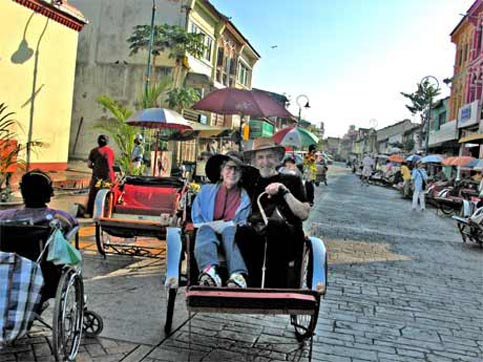 Disabled Travel is faciliated in Malayasia by riding in trishaws
