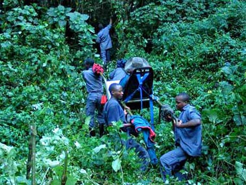 Travel Uganda - Disabled Travelers Guide - Porters carrying Nancy