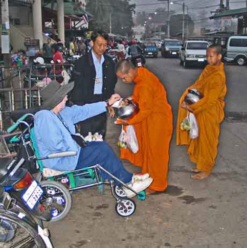 Travel disabled wheelchair see monks in thailand